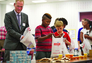 Donors, officials, volunteers participate in 'Blessings in a Backpack' program