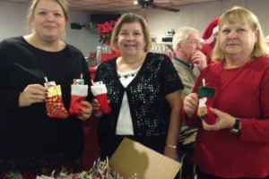 Melissa Russell and Beth Hallinan from Blessings in a Backpack were recently given stockings to add to their weekly bags of food.