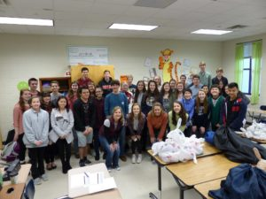 Lambert student volunteers pose for a photo at the end of a packing meeting.