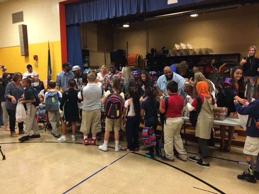 Linkin Bridge Packs Bags at Louisville Schools