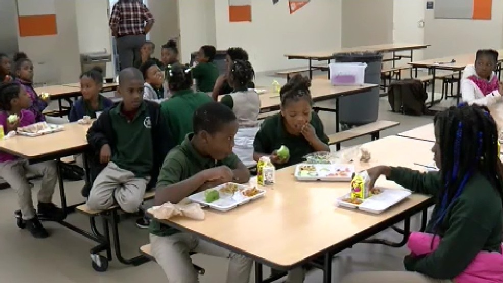 Nursing and rehab facility helps DC children by packing bags of food