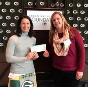 The Green Bay Packers Foundation presents a $2,000 check to the