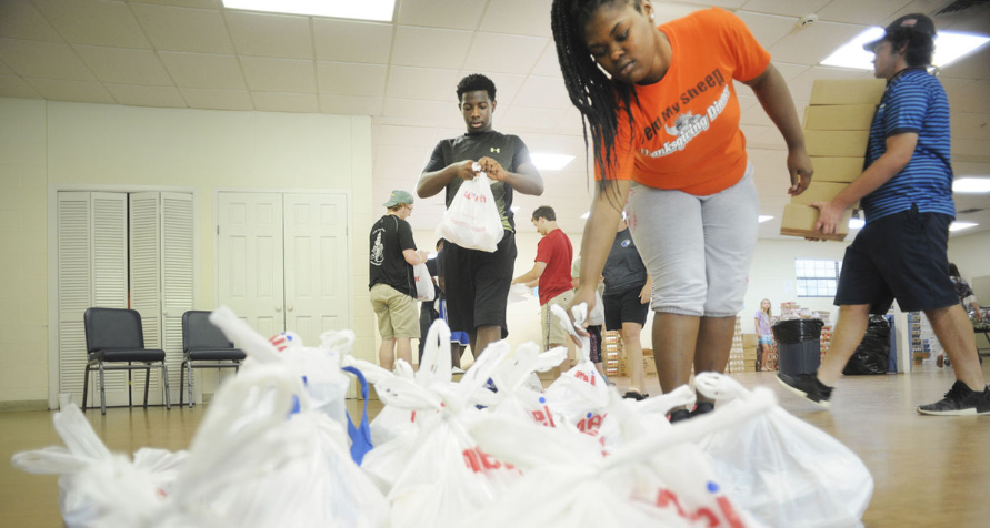 Gathering Place interns pack blessings in backpacks