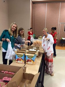 Junior League of Akron packs food for 435 children