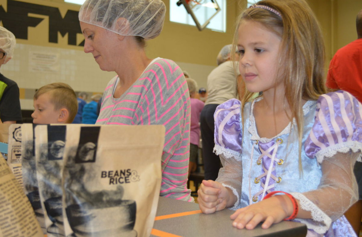 Feeding Frederick: Volunteers pack 10,000 meals for FCPS students in need