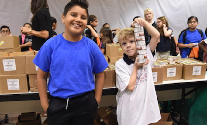 All Nevitt Students Receive Food Items, Books at Blessings in a Backpack Event