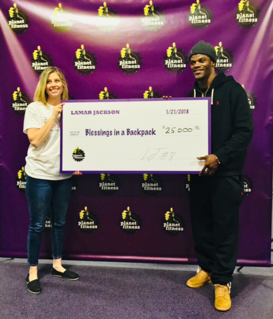 lamar jackson presents 25,000 check to blessings in a backpack