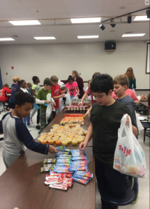 Garrison Mill students pack Blessings in a Backpack bags.