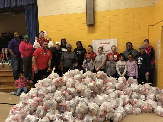 Engelhard teachers and staff pack 400 bags of food