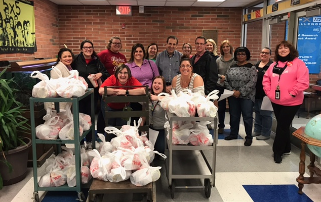 Teachers spent their unexpected day off delivering food to kids in need