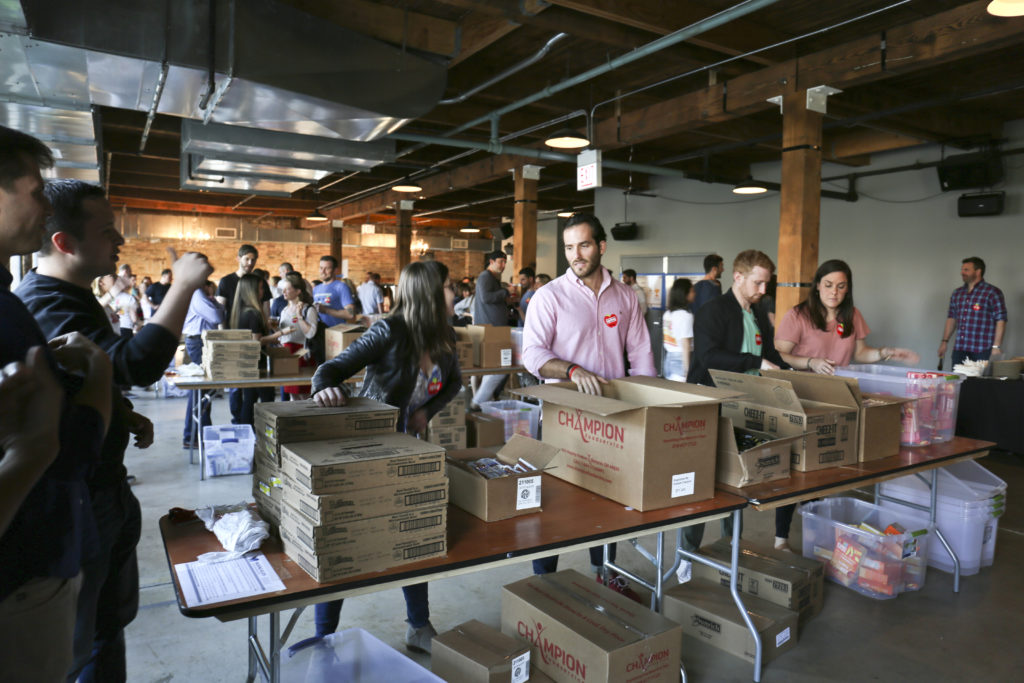 Teams Pack 1,800 Bags of Food at 2nd Annual Race to Feed Chicago