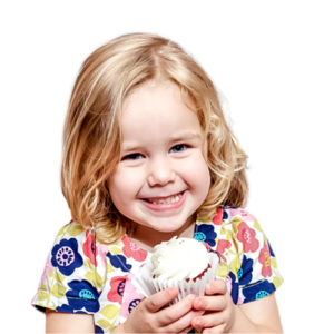 Picture of smiling little girl holding a cupcake