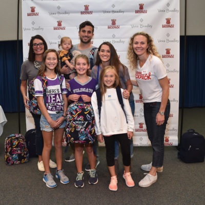 LOUISBURG, KS - AUGUST 23:  (L-R) Stefanie Chevillet, Jade Roper Tolbert, Emerson Tolbert, Tanner Tolbert, Erin Kerr and Broadmoor Elementary Students pictured during the Vera Bradley x Blessings in a Backpack 2018 event at Broadmoor Elementary School on August 23, 2018 in Louisburg, Kansas, United States. (Photo by Fernando Leon/Getty Images for Vera Bradley)