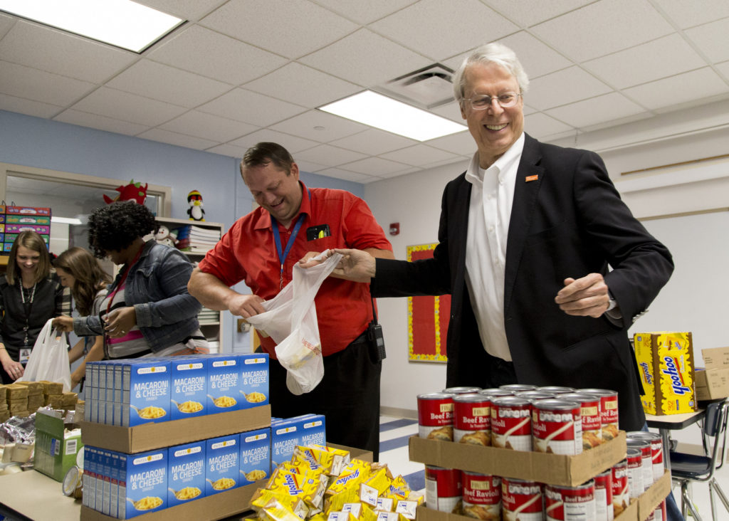 Mayors join local volunteers to pack backpacks full of food for children in-need on Blessings in a Backpack Day