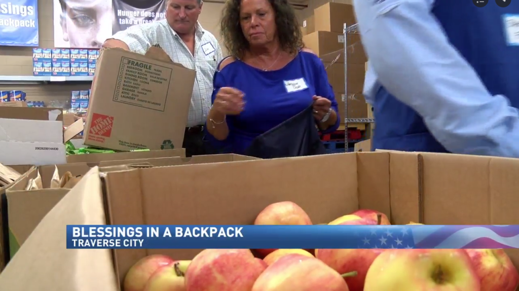 Father Fred kicks off Blessings in a Backpack for new school year