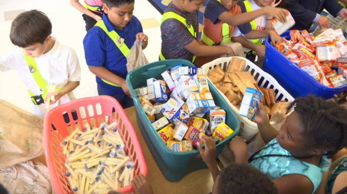 Students help Jacksonville mayor pack Blessings in a Backpack