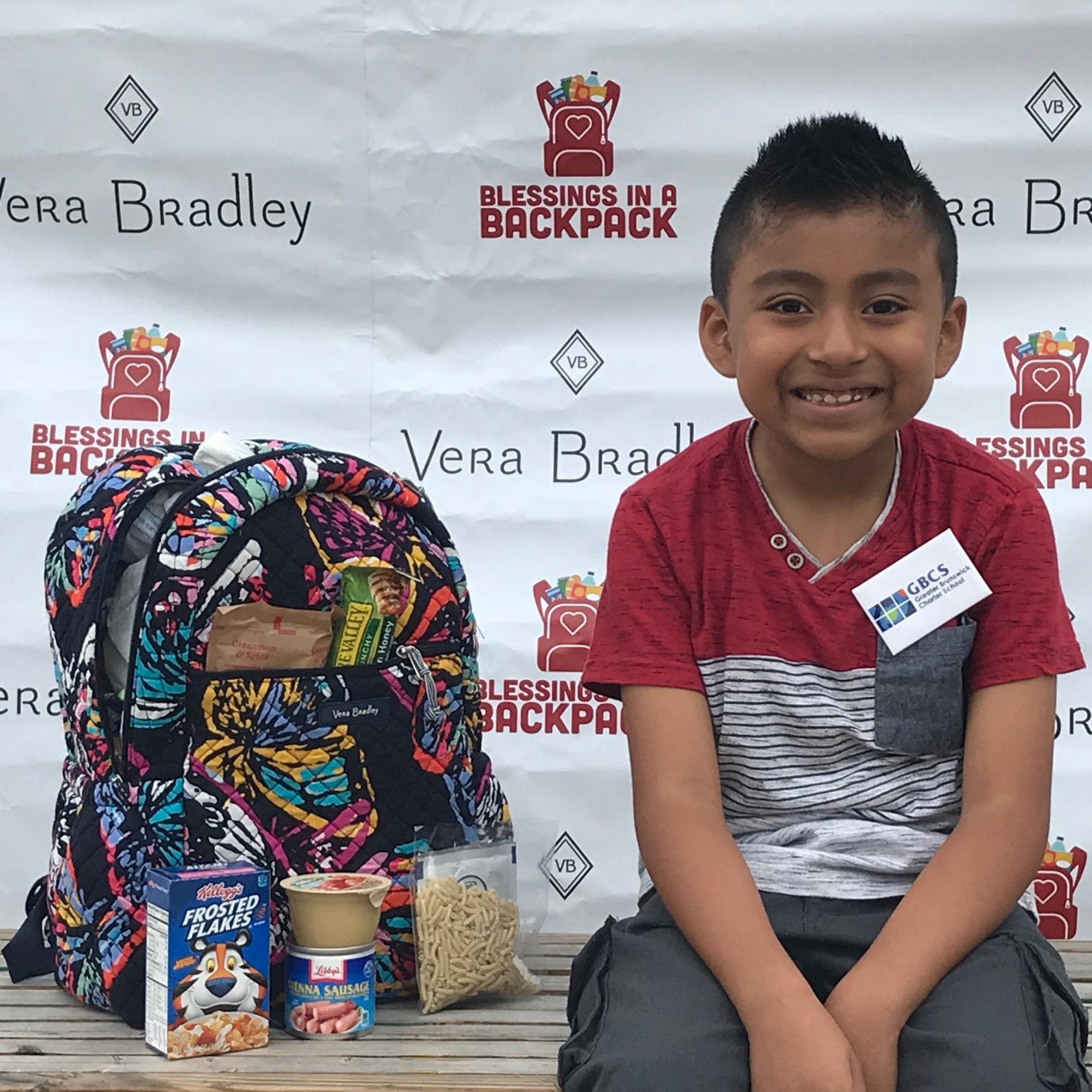 Boy with Vera Bradley backpack