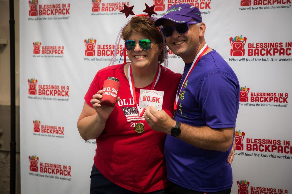 Couple posing at 0.5K race in Louisville