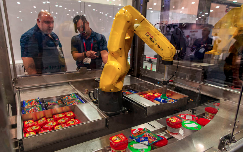 Robots at PACK EXPO Pack 6,000 Bags of Weekend Food