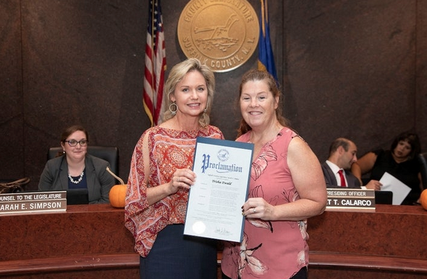 Legislator Anker Honors Blessings in a Backpack's Trisha Ewald
