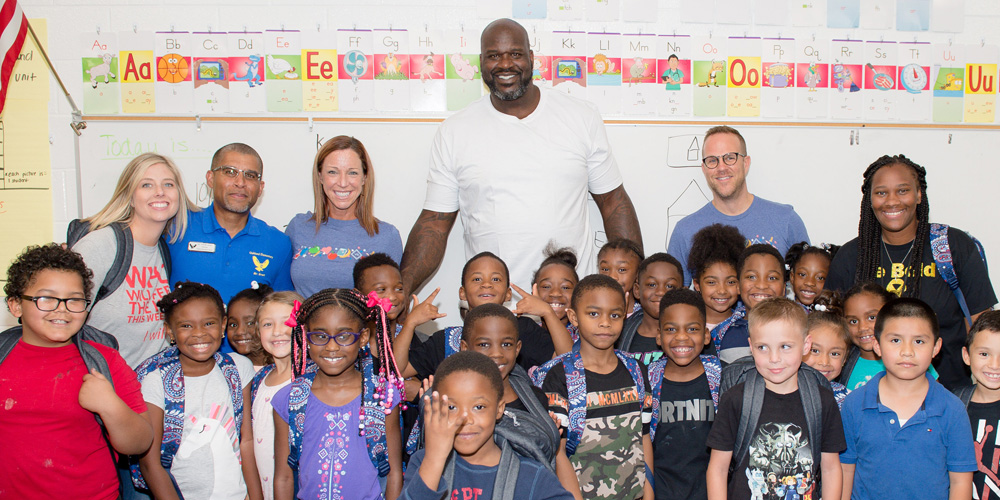 Shaq Packs Blessings in a Backpack