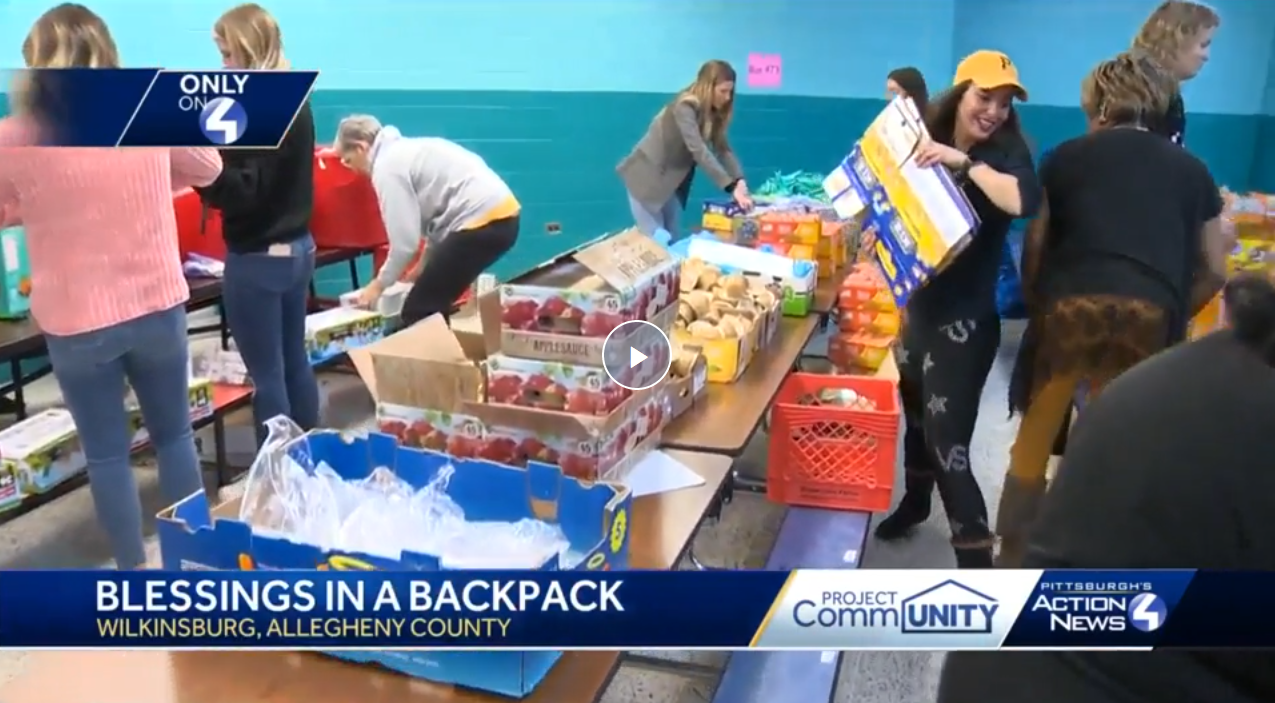 Wives, girlfriends of Pittsburgh Penguins help pack food for children