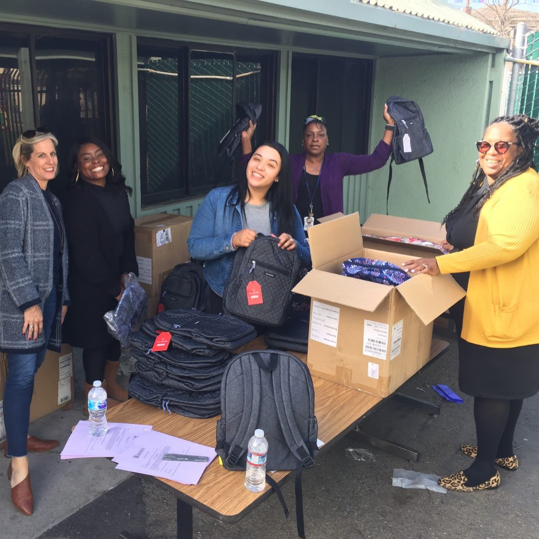 Related Affordable employees pack bags of food