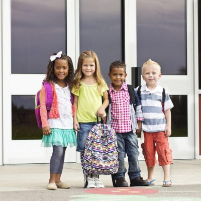 Photo of kids with backpacks