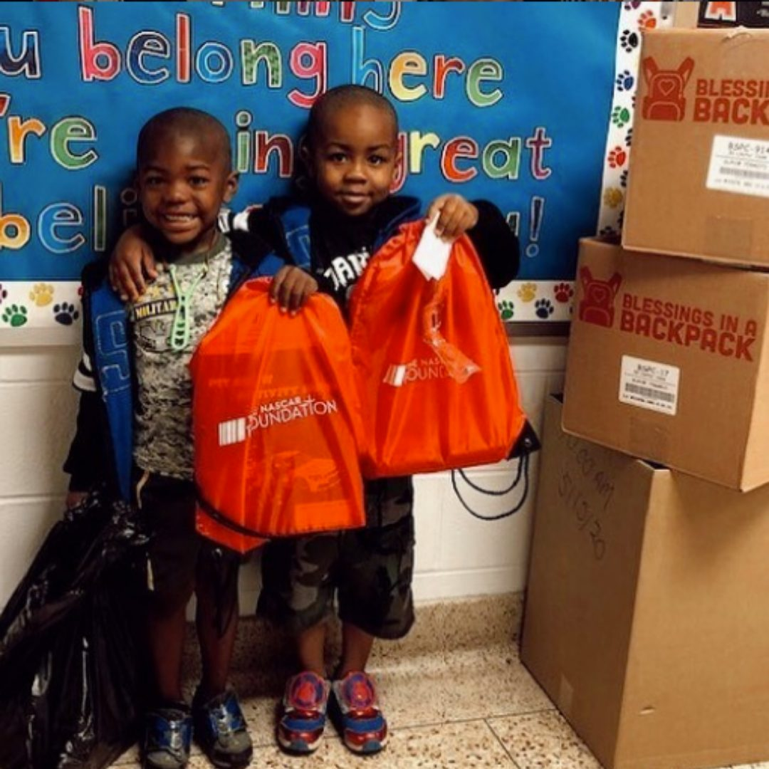 Kids holding bags of food