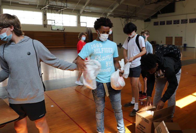Students Utilize Money from Ravens Loss to Pack Bags of Food for Blessing in a Backpack