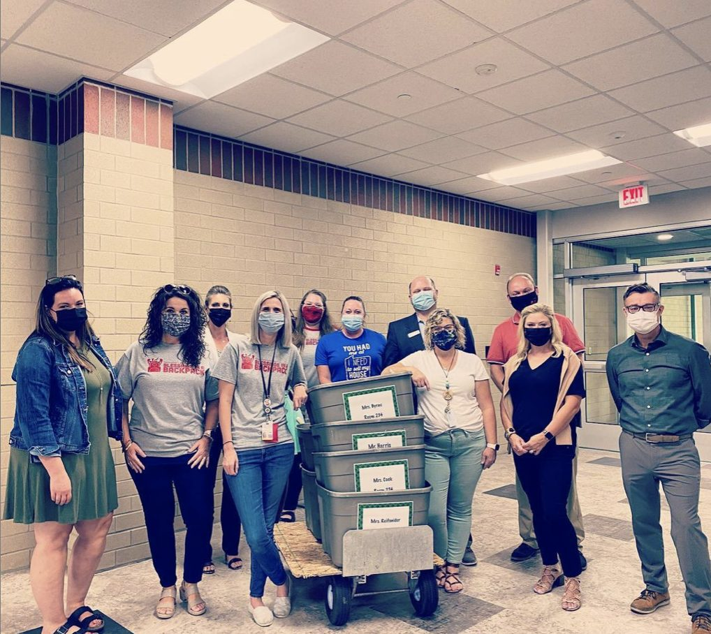 New Albany leaders volunteer to pack food for Blessings in a Backpack